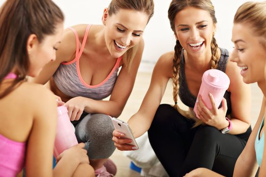 Picture showing young women group resting at the gym after workout
